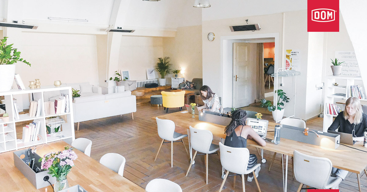 an empty coworking space with three women working apart