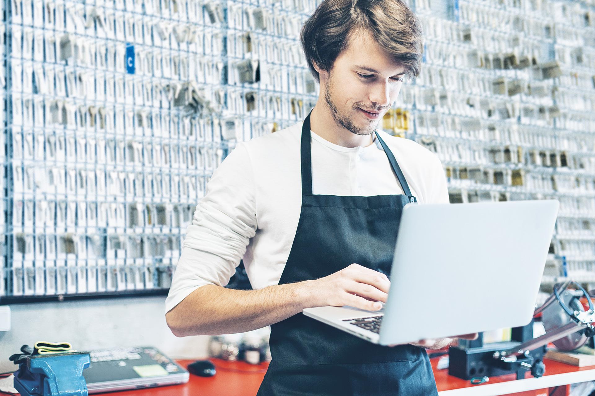Locksmith standing behind his laptop