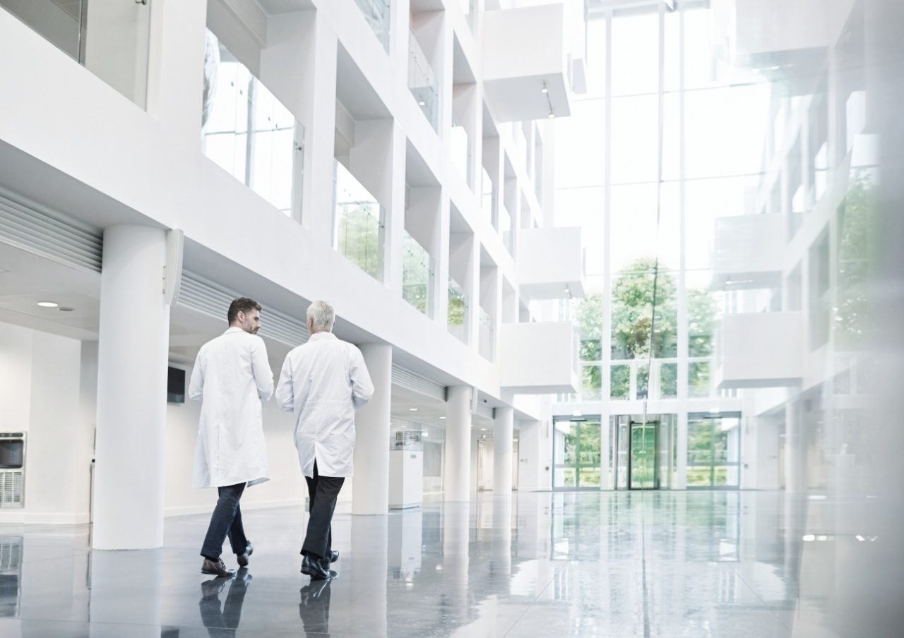 two male doctors walking in a hospital hallway