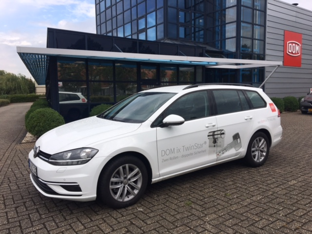 company car wrapped with DOM branding