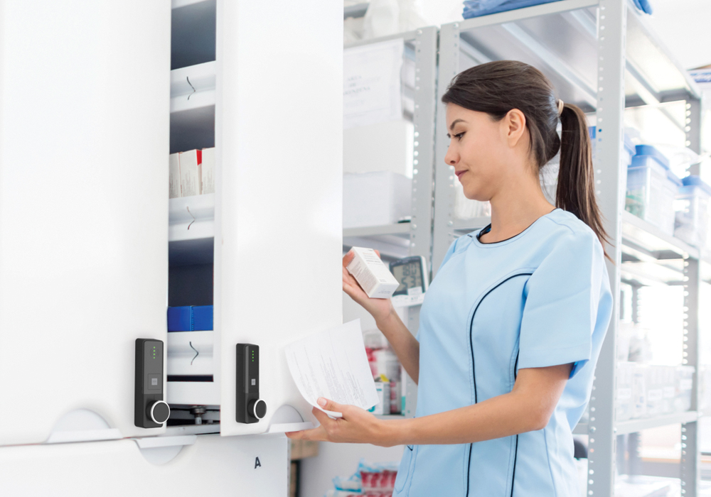 Woman opening medicine cabinet with ENiQ LoQ