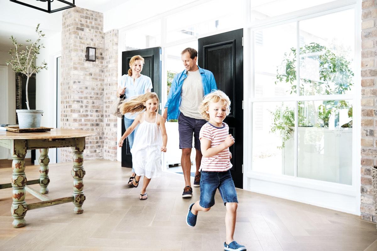 Family entering a house
